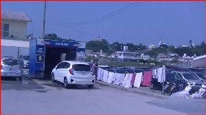 沖縄へ レンタカー洗車場。 いよいよ旅も終わりへと。